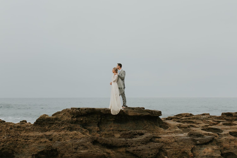 A bride and groom eloping at Laguna Beach in California.