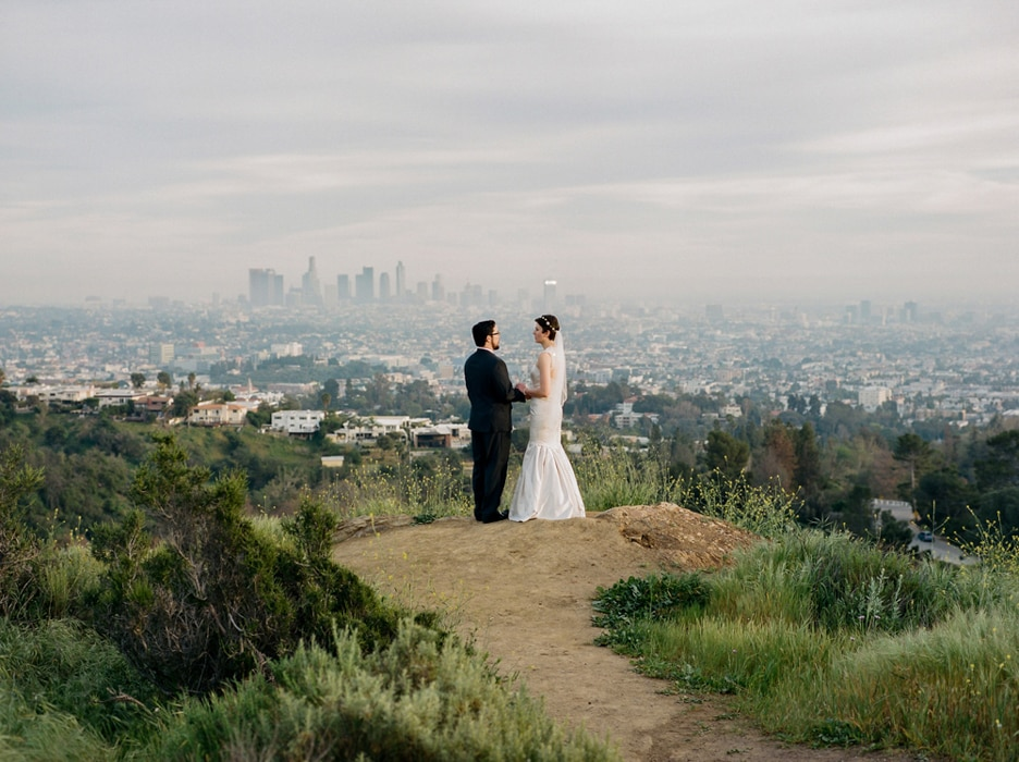 A bride and groom standing in Griffith Park, a wedding venue in Los Angeles.