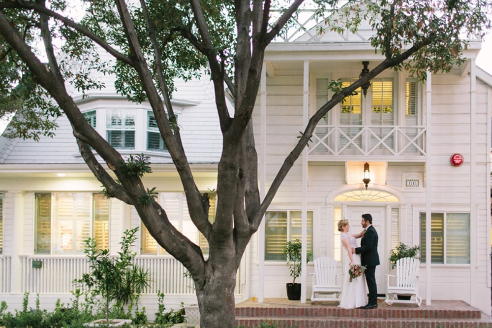 A couple hugging outside of the Lombardi House, an outdoor and indoor wedding venue in Los Angeles.