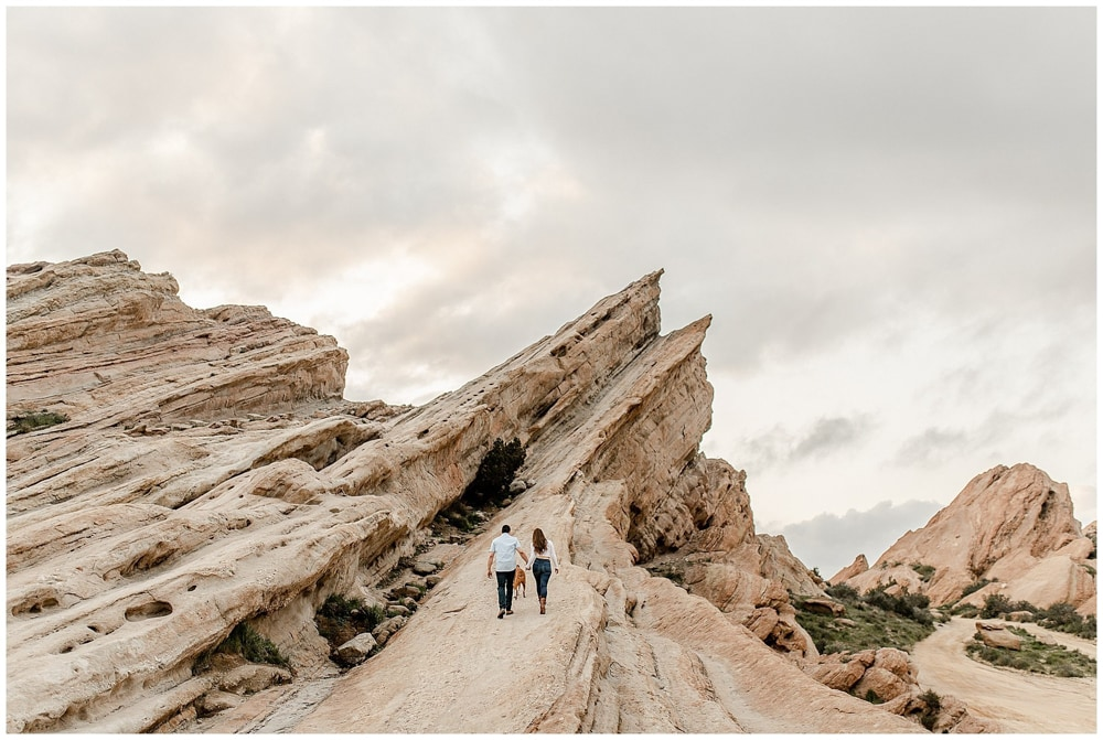 A couple walking on Vasquez Rocks, a wedding venue in Los Angeles.