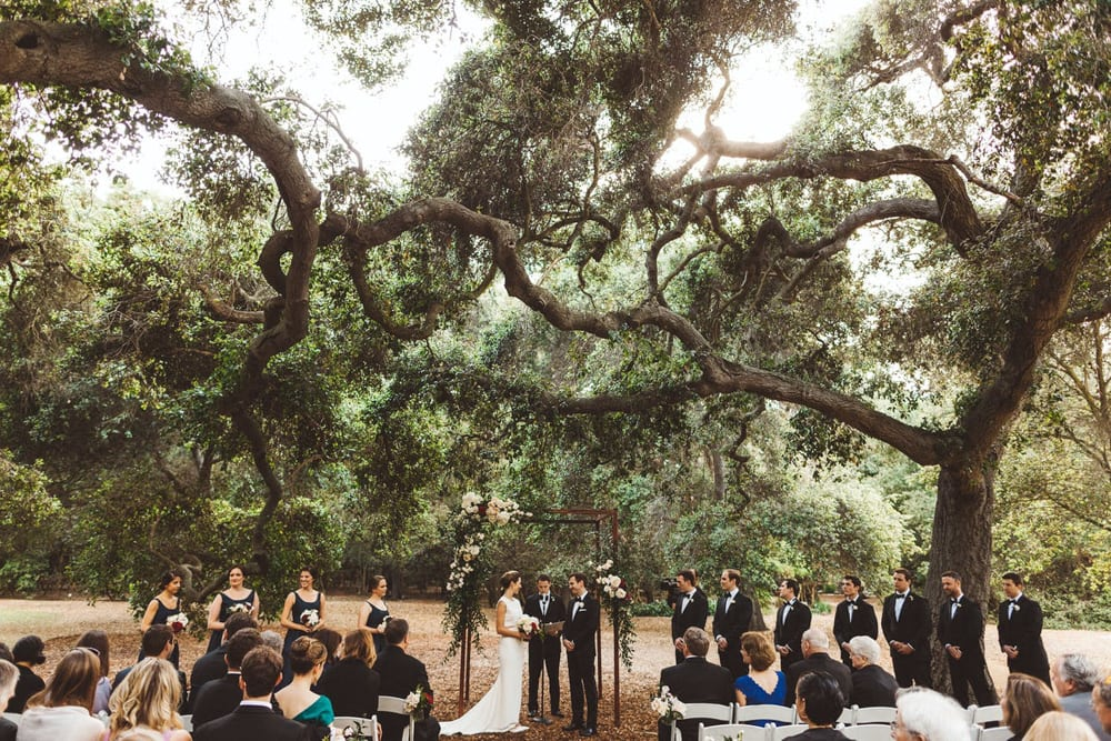A bride and groom getting married at Descano Gardens, an outdoor wedding venue in Los Angeles.
