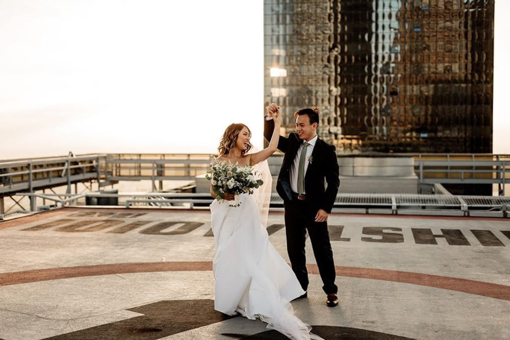 A couple dancing on the rooftop of TenTen Wilshire, an indoor and outdoor wedding venue in Los Angeles, California.