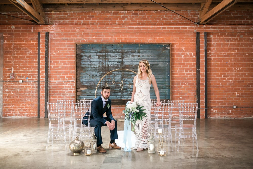 A bride and groom posing in Seventh/Place, an indoor wedding venue in Los Angeles.