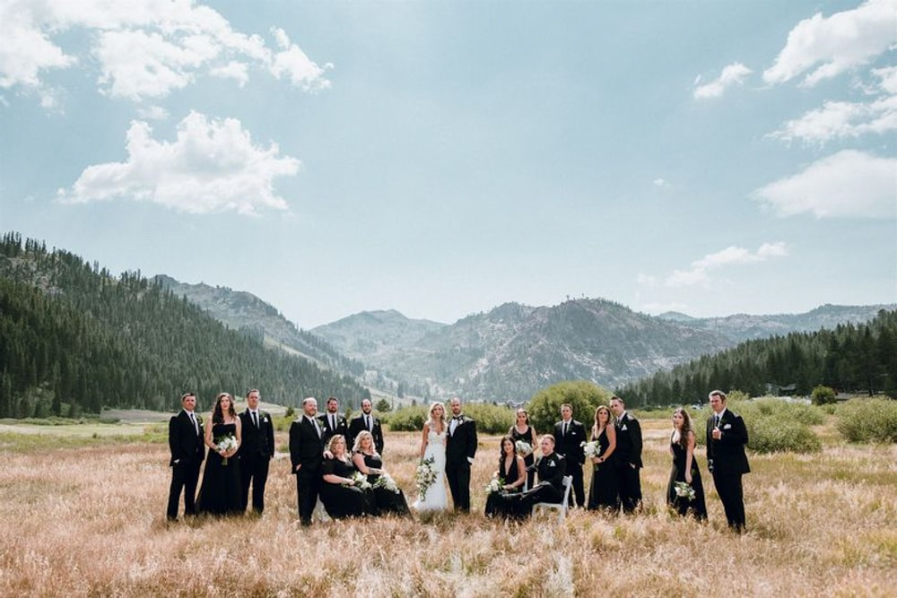 A bridal party standing in the meadow of the Resort at Squaw Creek​, a wedding venue in Lake Tahoe.