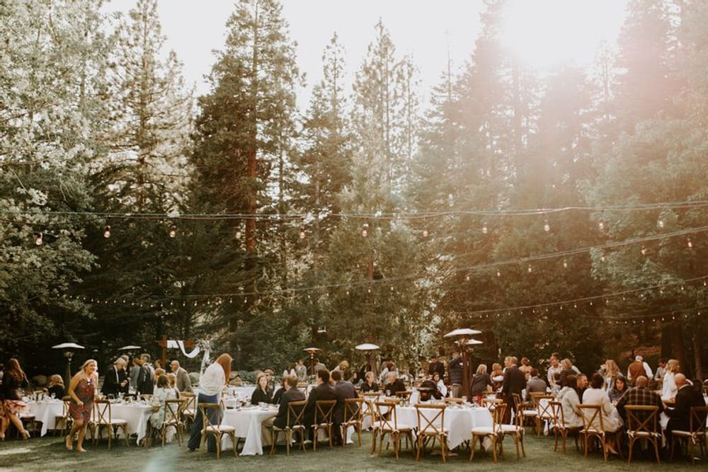An outdoor wedding reception at Granlibakken Tahoe​, an outdoor wedding venue in Lake Tahoe.
