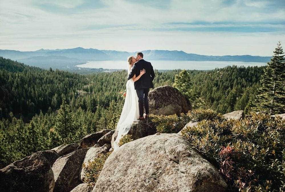 A couple kissing at the top of Tahoe Blue Estate​, a wedding venue in Lake Tahoe.