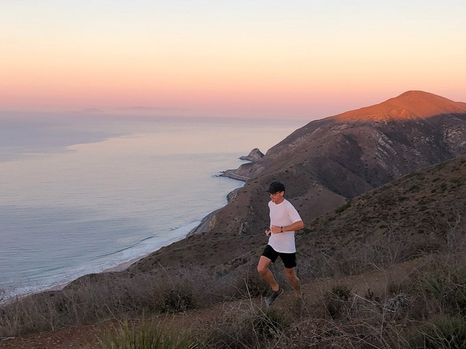 A jogger running along the coast of Point Mugu State Park, an outdoor wedding venue in Malibu.
