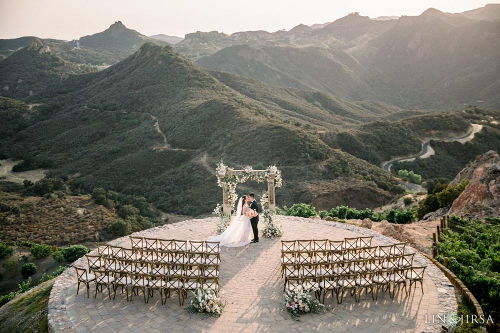 A couple kissing at Malibu Rocky Oaks Estates Vineyard, an outdoor wedding venue in Malibu.