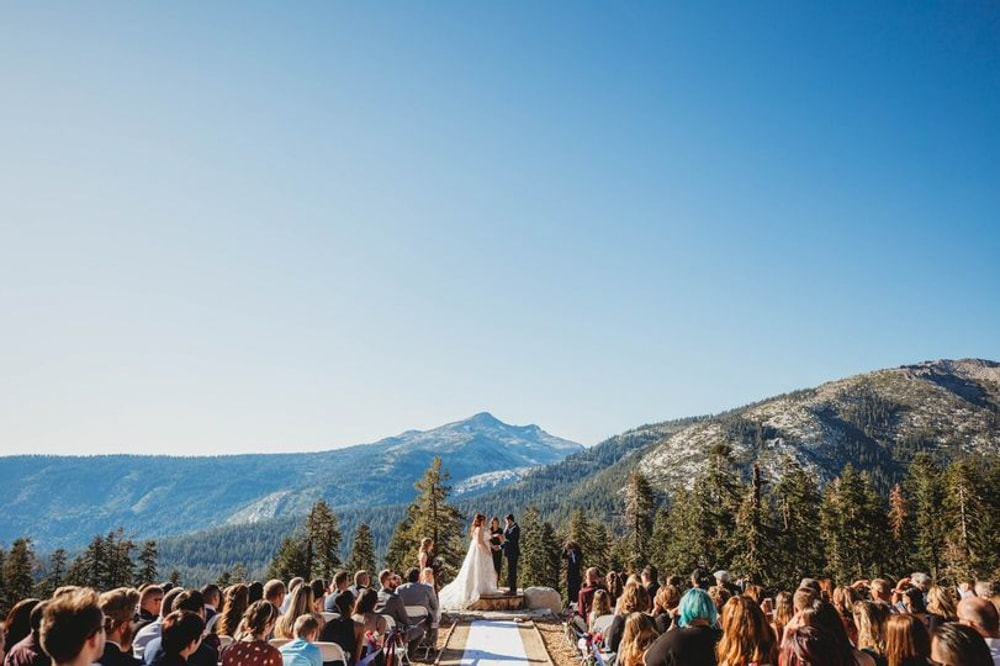 A bride and groom getting married at Sierra-at-Tahoe, a wedding venue in Sacramento.