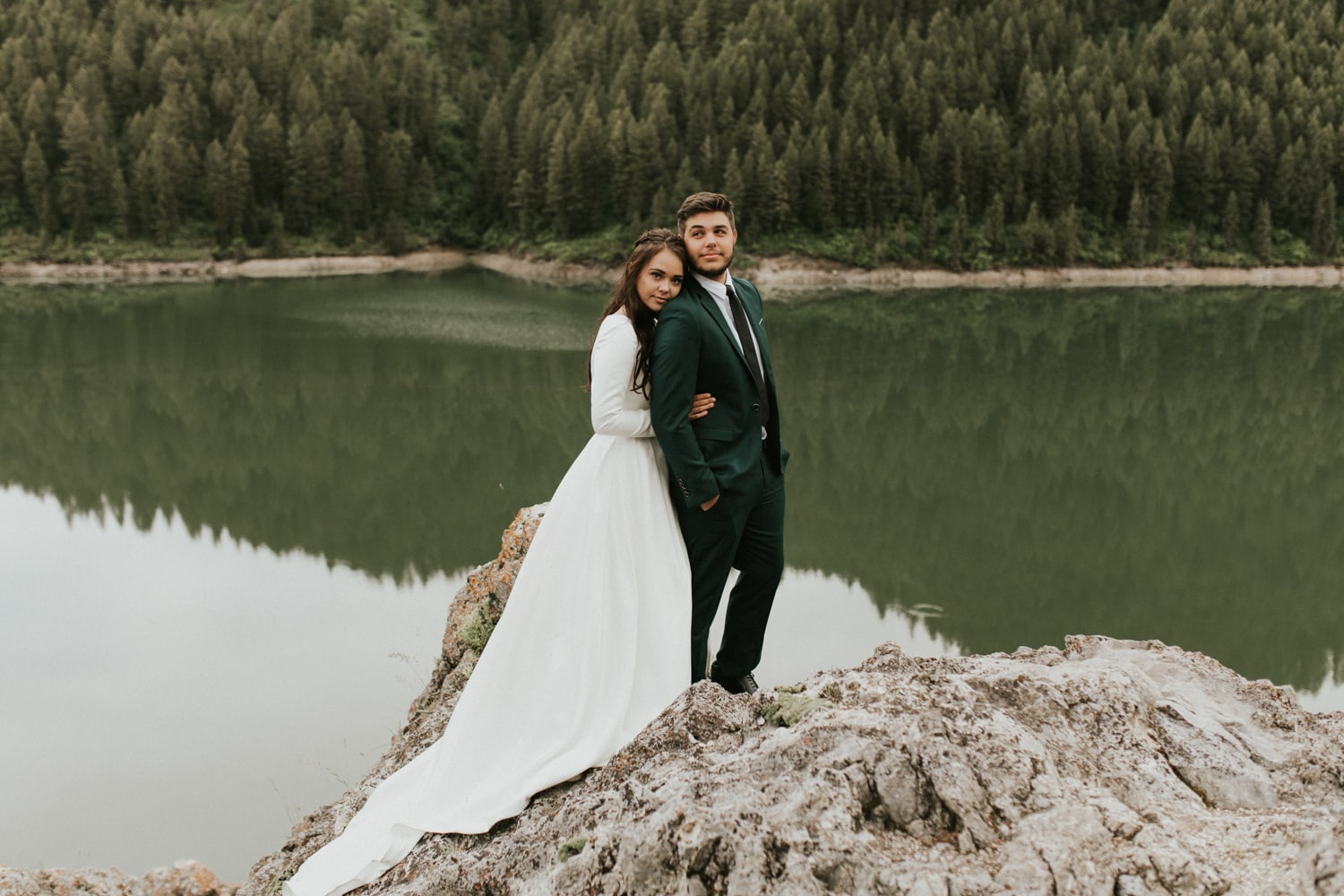 A bride and groom hugging and getting married in the mountains of California.