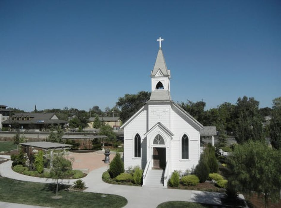 An image of St. Mary's Chapel, a white wedding chapel in Sacramento.