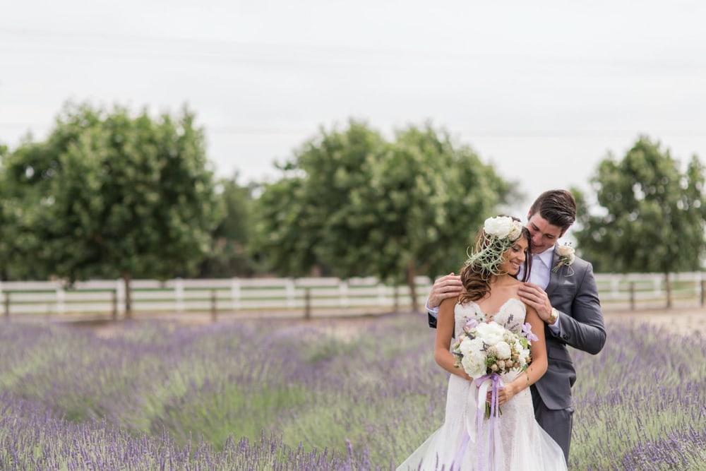 A couple hugging at Pageo Lavendar Farm, a Sacramento wedding venue.