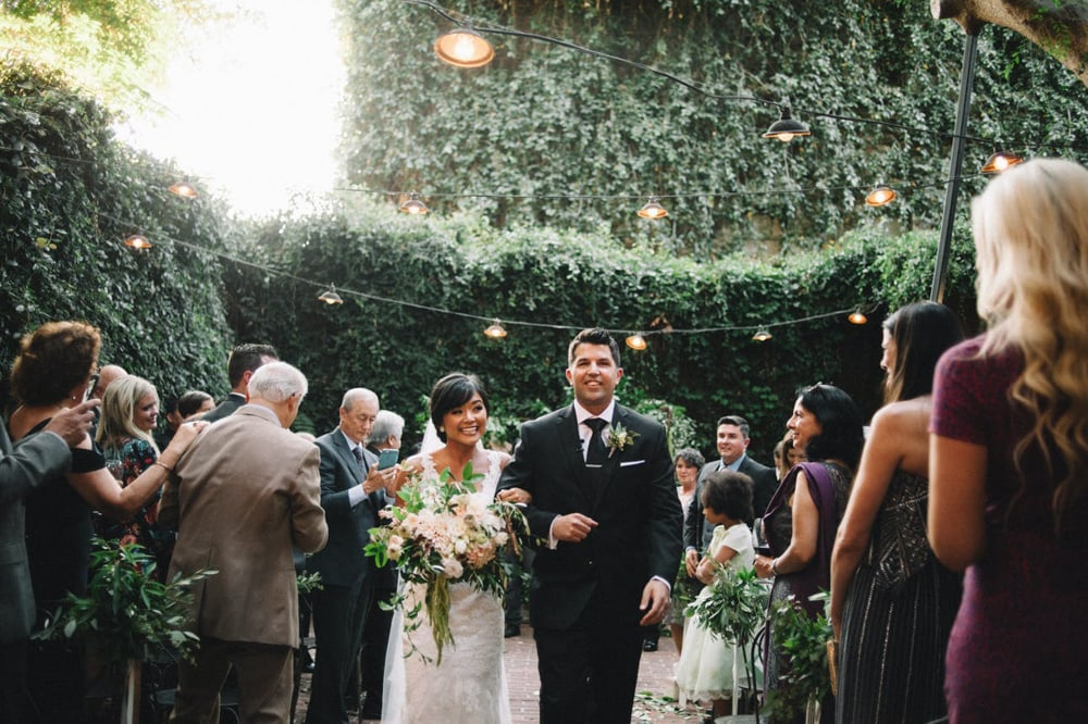 A bride and groom walking down the aisle at The Firehouse, a wedding venue in downtown Sacramento.
