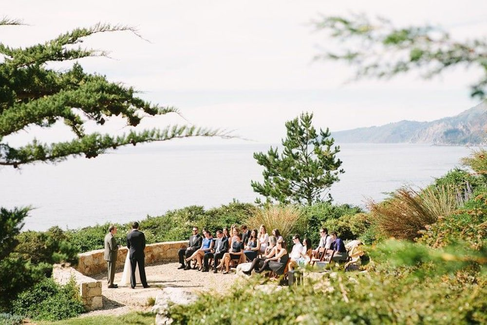 A wedding ceremony  on the coast at Wind and Sea, a Big Sur wedding venue.
