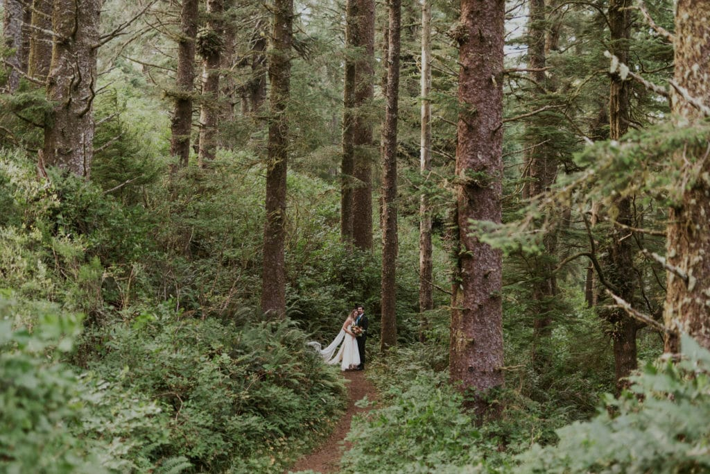 A couple hugging in an Oregon forest on their wedding day.
