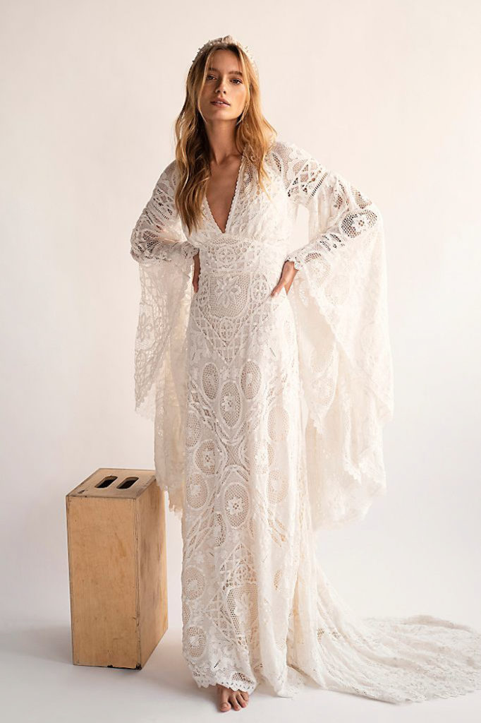 A model wearing a forest wedding dress from Free People.
