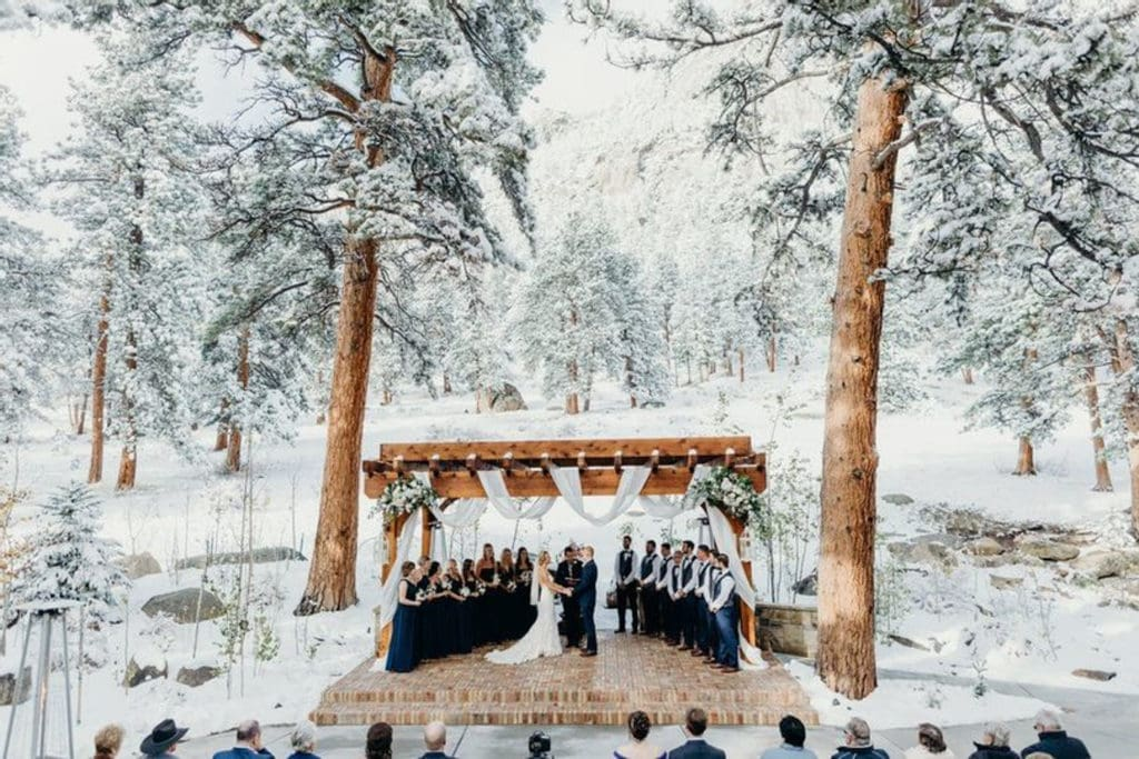 A couple getting married at Della Terra mountain Chateau, a mountain wedding venue in Estes Park, Colorado.