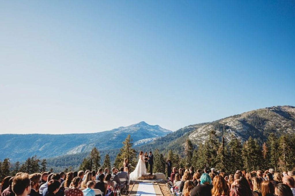 A couple exchanging vows at Sierra-at-Tahoe, a mountain wedding venue at Lake Tahoe.