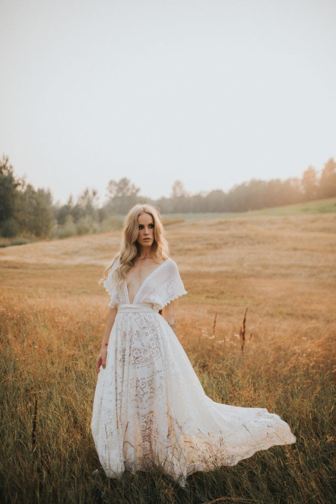 A model wearing a bohemian forest wedding dress from Reclamation.