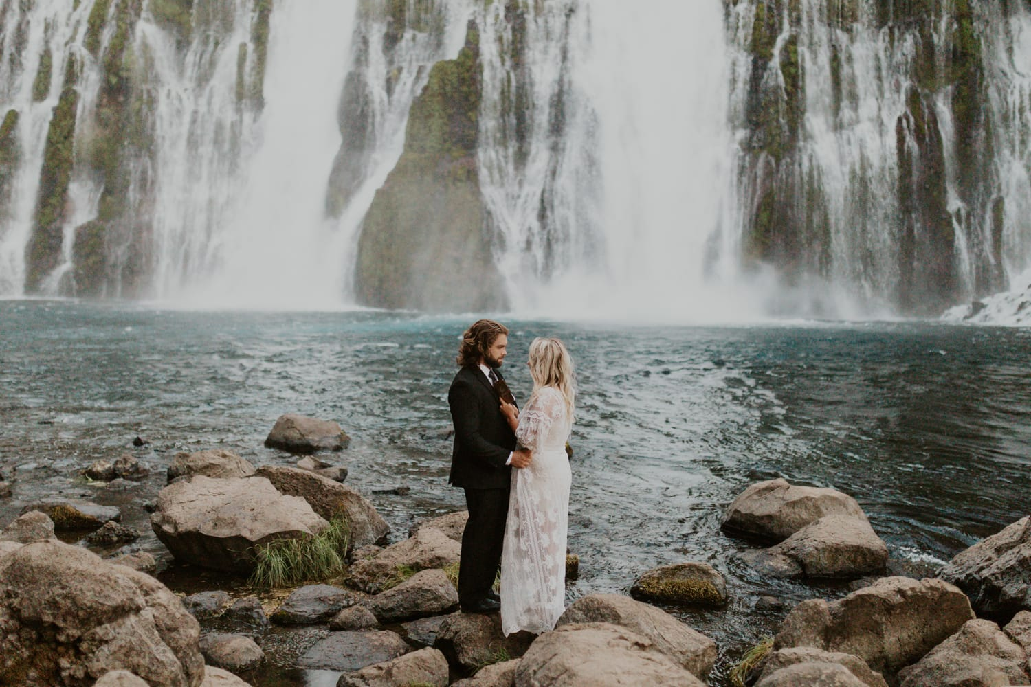Vow reading at a waterfall.