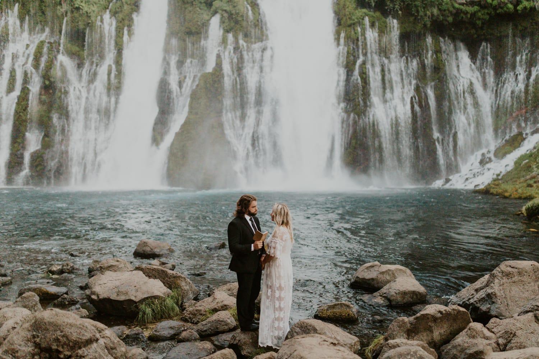 A couple having a wedding at Burney Falls.