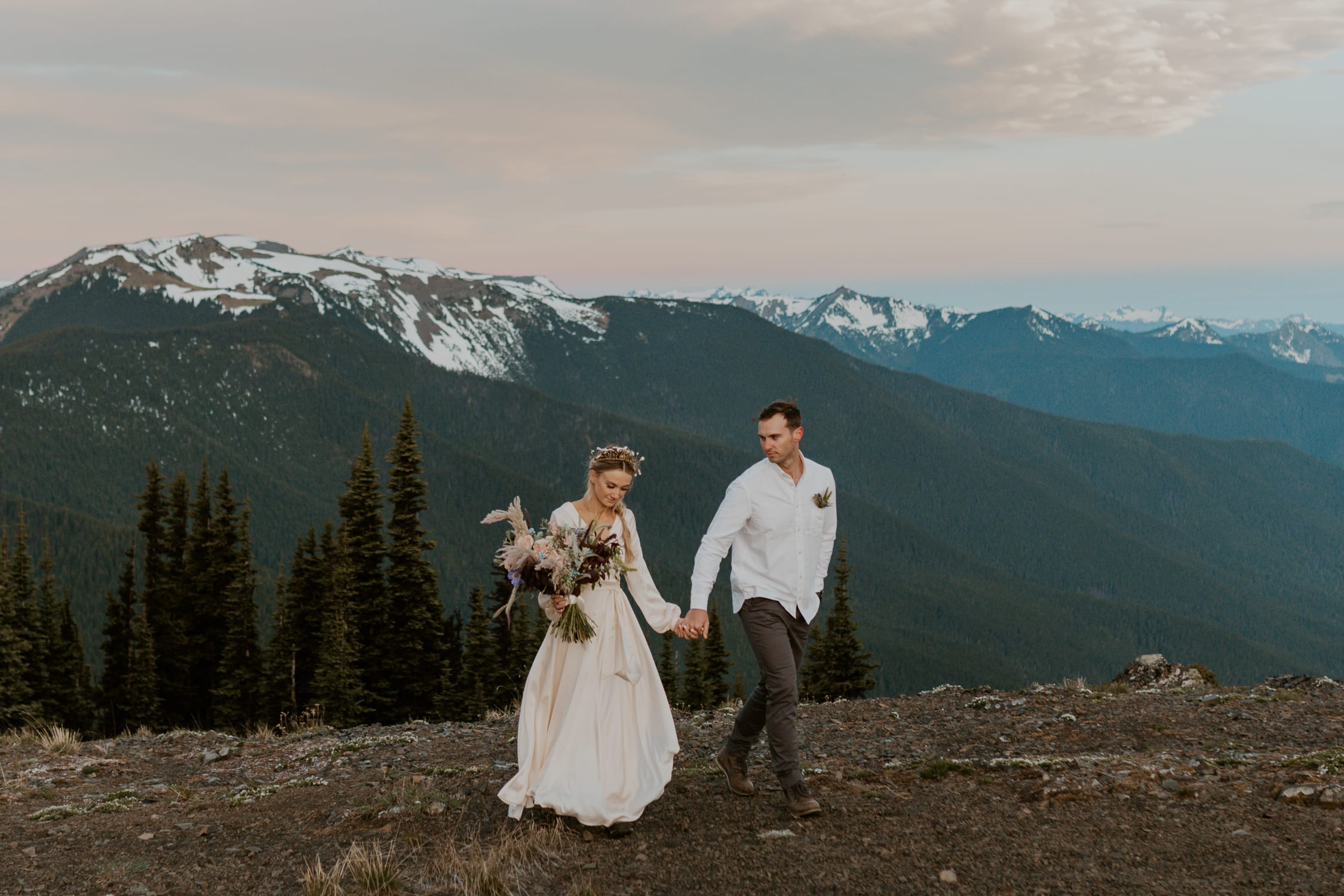A couple holding hands and walking at Hurricane Ridge in Olympic National Park.