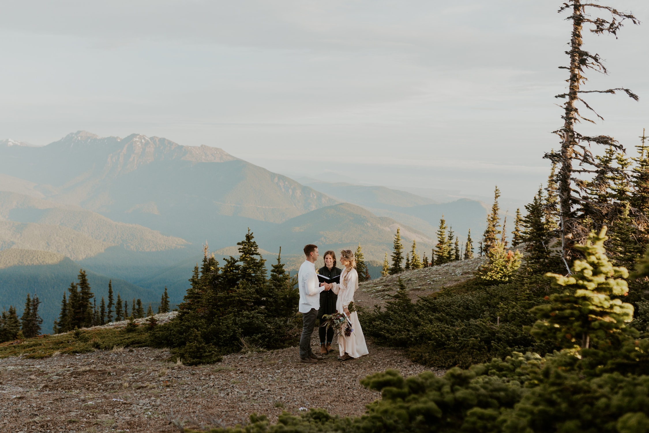 A couple exchanging vows on their wedding day at Hurricane Ridge in Olympic National Park.