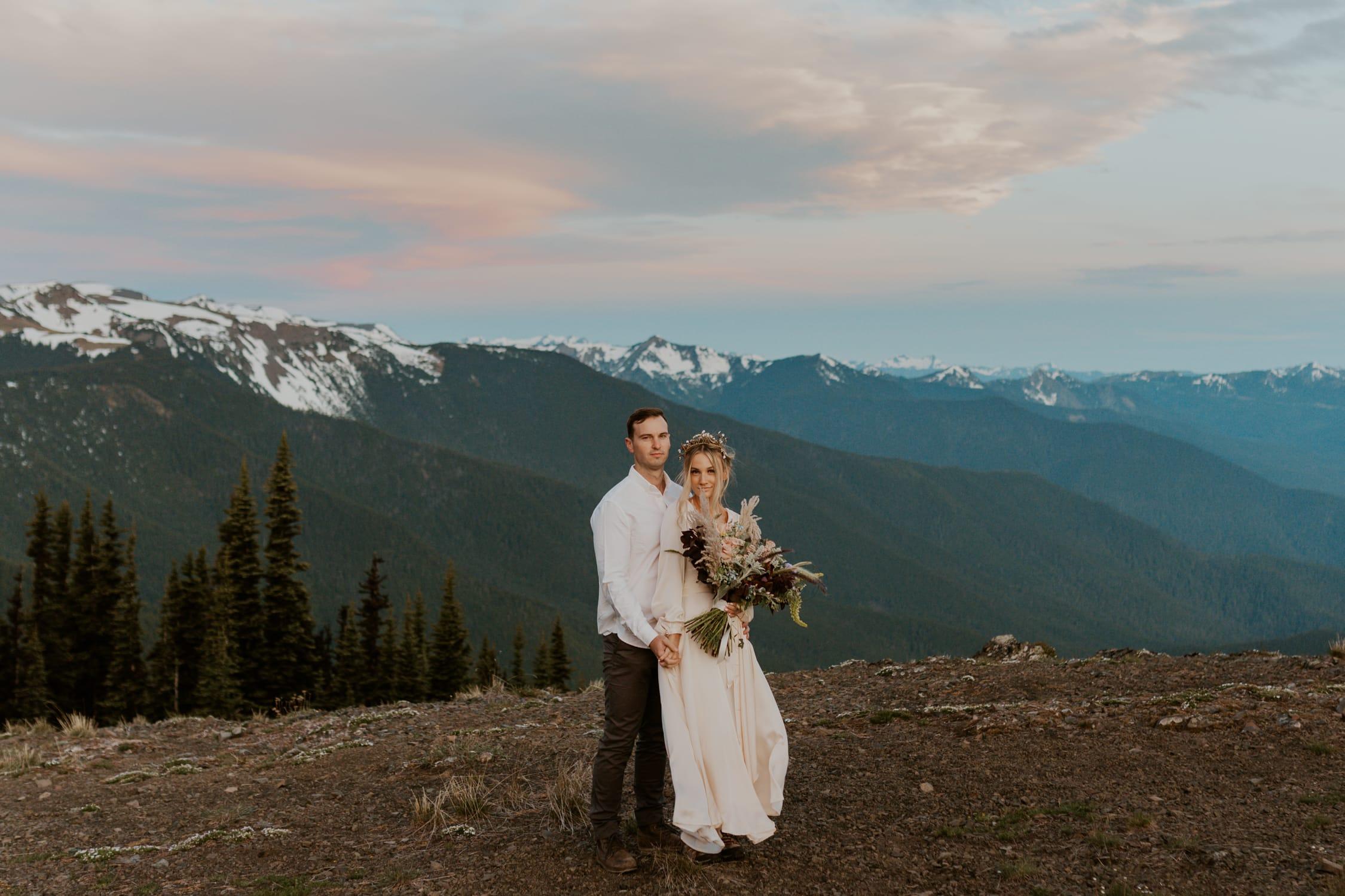 A couple eloping and looking at the camera at Hurricane Ridge.