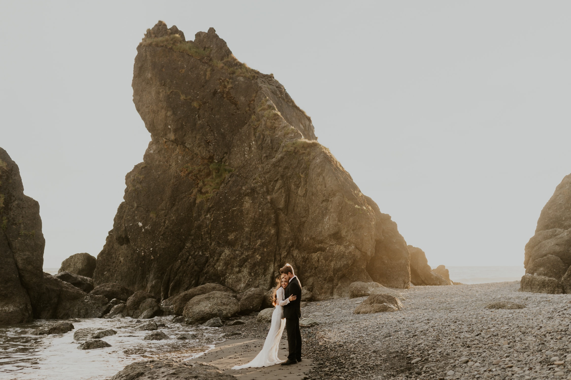 A couple hugging during their elopement on Ruby Beach.
