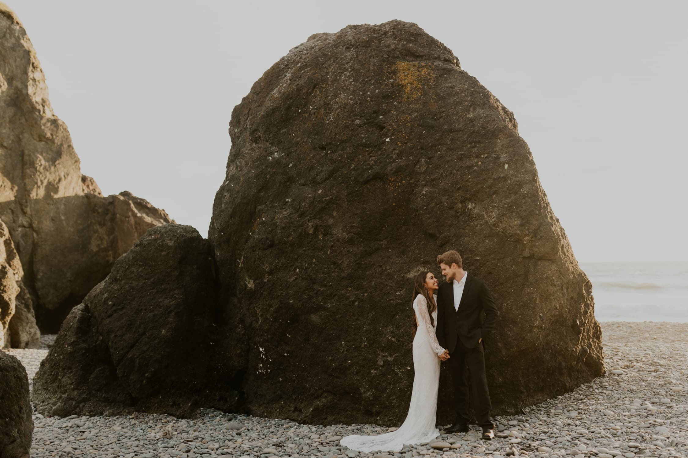 A couple eloping on Ruby Beach in Olympic National Park in the summer.