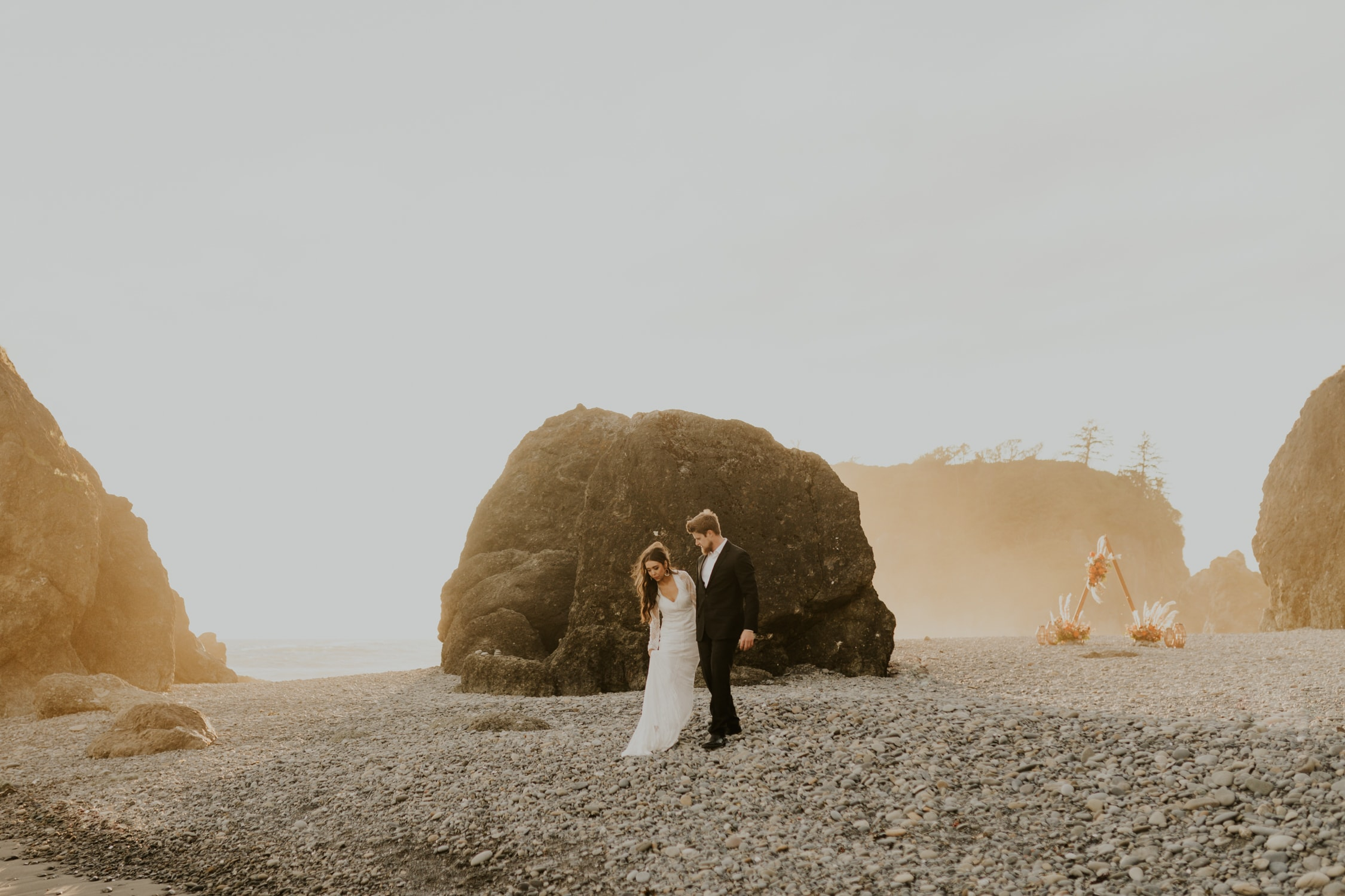 A couple walking on Ruby Beach during their elopement.