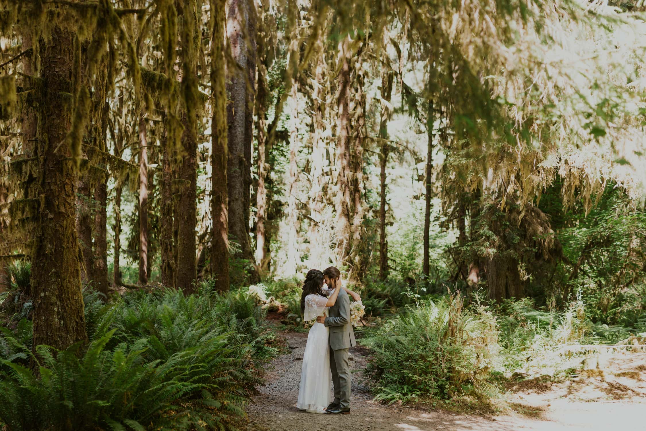 A couple eloping in Washington State at the Hoh Rainforest.